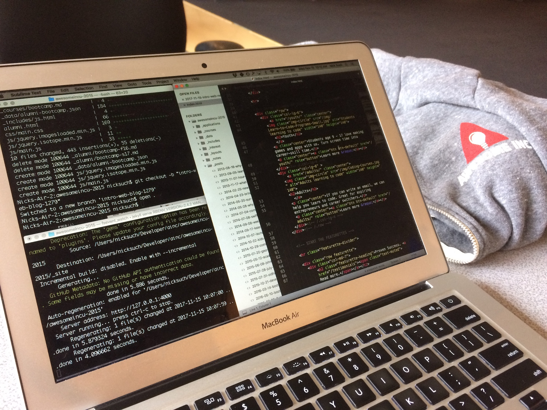 Laptop with terminal and text editor with HTML code